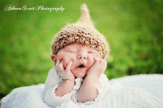 new jersey doula services baby in a field with acorn hat on
